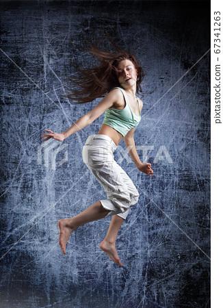 beauty girl dance on grunge background 67341263