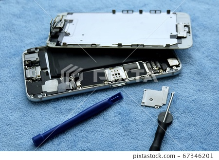 Person Repairing Smartphone with A Screwdriver 67346201