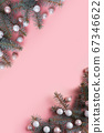 Christmas white balls and fir branches on pink. 67346622
