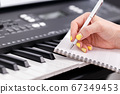 Musician writing music close up 67349453