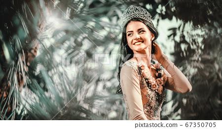 Gorgeous woman pose outdoor 67350705