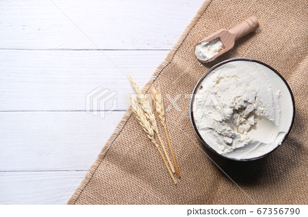 Production of wheat and rye flour on white desk 67356790