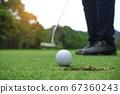 Blurred golfer playing golf in beautiful golf 67360243