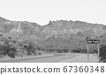 Ghost Town of Old Trails Sign on Route 66 in the Sonoran Desert, Arizona USA in Black and White 67360348