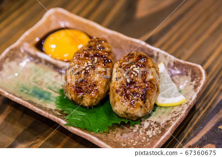 Traditional Japanese grilled chicken, Yakitori, with marinated egg yolk 67360675