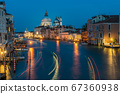 Basilica di Santa Maria della Salute and grand canal from Accademia Bridge at night in Venice, Italy. 67360938