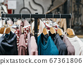 fashion clothing on hangers at the show 67361806