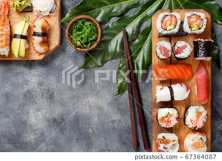 Sushi Set nigiri and sushi rolls on a wooden tray 67364087