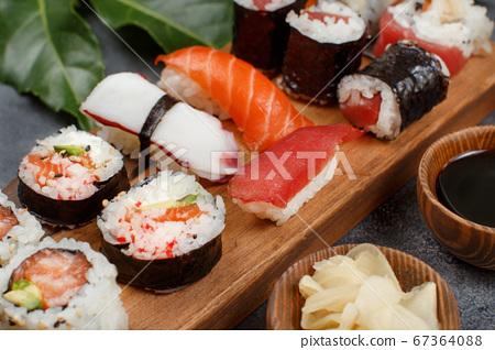 Sushi Set nigiri and sushi rolls on a wooden tray 67364088