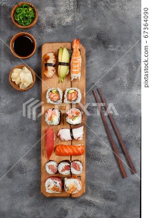 Sushi Set nigiri and sushi rolls on a wooden tray 67364090