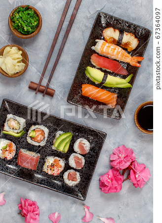 Sushi Set nigiri and sushi rolls on rectangular 67364097