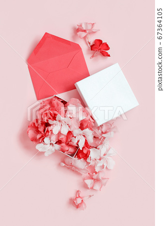 Red envelope and gift box full of flowers  over a 67364105