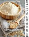 Raw white quinoa seeds and flour close up 67364120