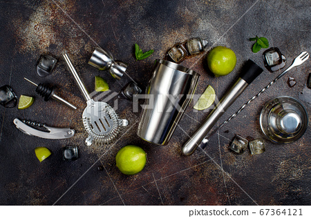 Bartender tools, lime, mint and ice 67364121