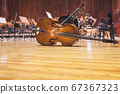 Cello Music instruments Orchestra music on a stage 67367323