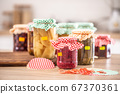 Variety of home made pickles and preserves 67370361