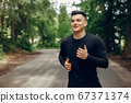 Sports man in a morning summer park 67371374