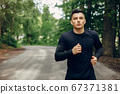 Sports man in a morning summer park 67371381