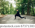 Sports man in a morning summer park 67371383