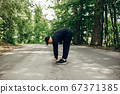 Sports man in a morning summer park 67371385
