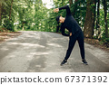 Sports man in a morning summer park 67371392
