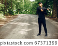 Sports man in a morning summer park 67371399