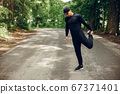 Sports man in a morning summer park 67371401