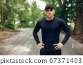 Sports man in a morning summer park 67371403