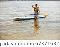 Sup surfer on a summer beach 67371682