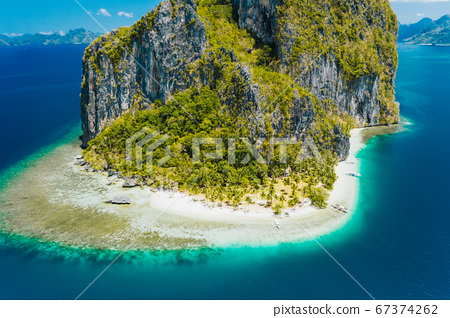 El Nido, Palawan, Philippines. Aerial drone view of impressive Pinagbuyutan Island. Amazing white sand Ipil beach with turquoise blue ocean and coral reef 67374262