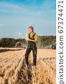 Farmer woman monitoring business progress of the harvest 67374471