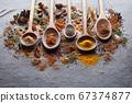 Spices powder on graphite board 67374877
