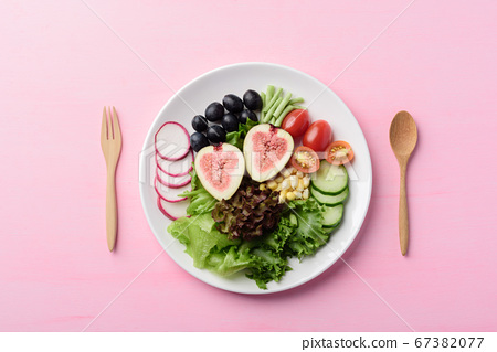 Salad with fruits and vegetables on plate, Vegan food 67382077