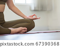 Close up hands of woman doing yoga lotus pose at in the morning to meditation and relax balance for good health,Healthy Concept 67390368