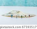 Miniature world concept- Miniature figurine of traveler, businessman, couple, family 033 67393517