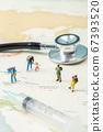 Miniature world concept- Miniature figurine of traveler, businessman, couple, family 019 67393520