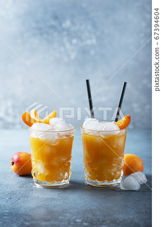 Summer juice with apricots and ice 67394604
