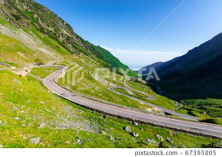 winding mountain road on a sunny day. empty 67395805