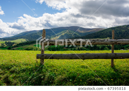 fence on the hill in rural area. early autumn 67395818