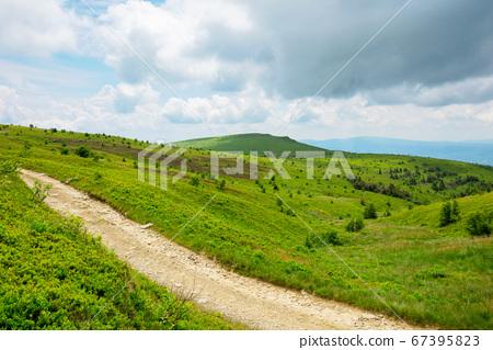 path through mountain landscape. road through 67395823