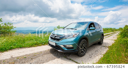 suv on the mountain road 67395824
