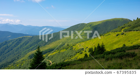 summer mountain landscape. green hills rolling in 67395835
