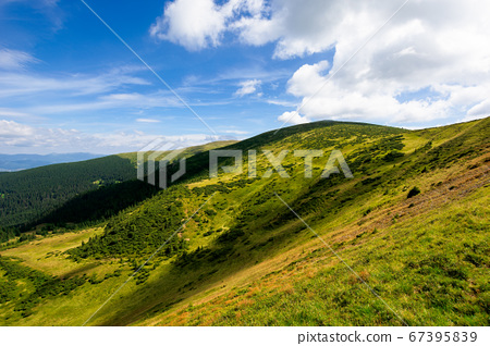 hills and valley of summer mountain landscape. 67395839