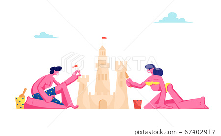 Young Loving Couple Having Leisure on Sandy Beach Building Sand Castle at Tropical Island Seaside. Man and Woman in Swimsuits 67402917