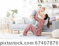 Unconditional Love. Happy young mom enjoying time with toddler son at home 67407876