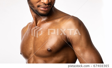 Muscular African Man Posing Over White Background, Studio Shot, Cropped 67408365