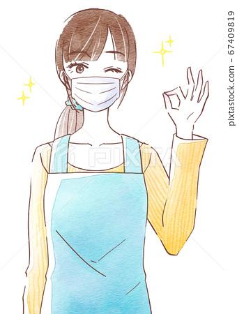 一個好的姿勢,帶著面具和圍裙的年輕女子 67409819