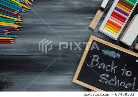 School supplies on black board background.  67409832