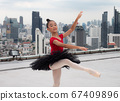 Ballet girl students show jumping skills while performing outdoors on a high-rise building. 67409896