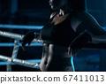 Female fighter posing near ring. 67411013